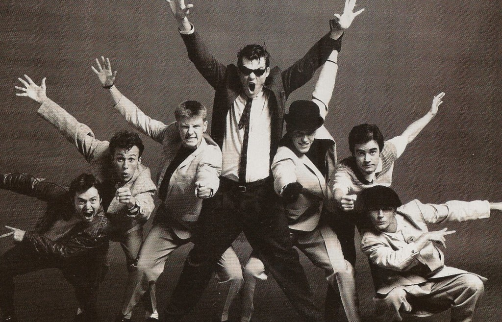 madness-arms-up